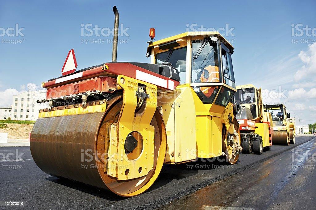 asphalt roller at work stock photo