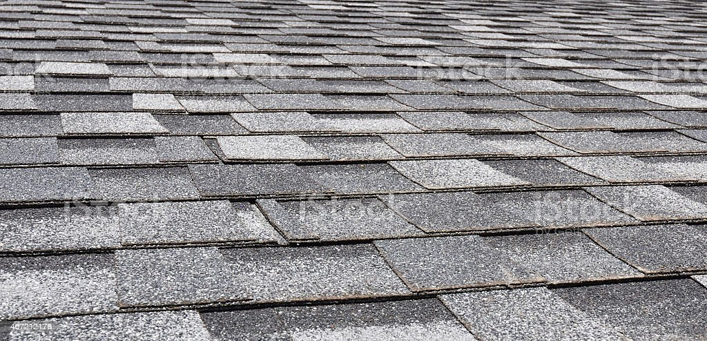 Asphalt Roofing Shingles Background. Close up stock photo