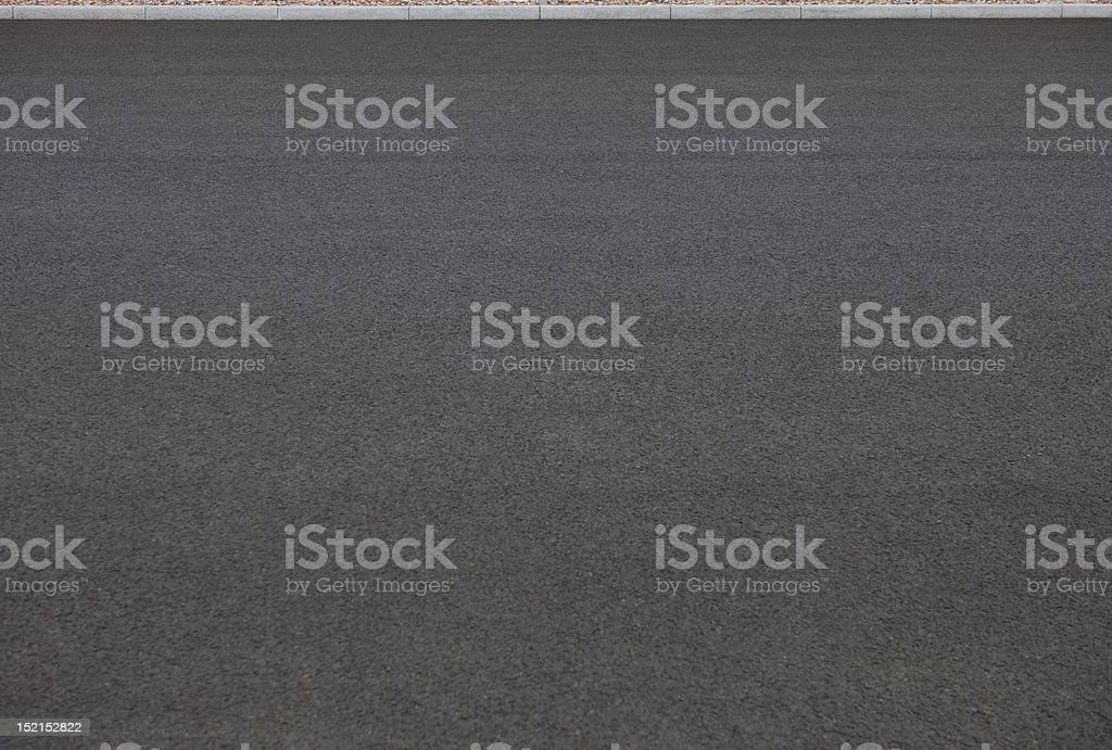 Asphalt structure and Curbstones stock photo