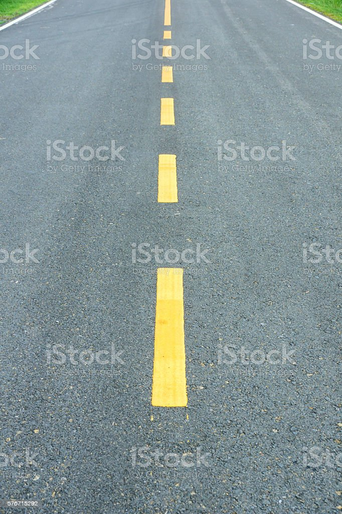 asphalt texture with yellow dashed line. stock photo