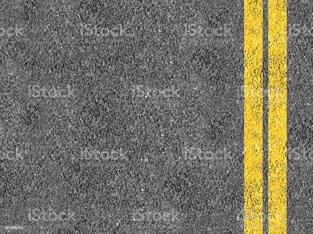 Asphalt with double yellow lines stock photo