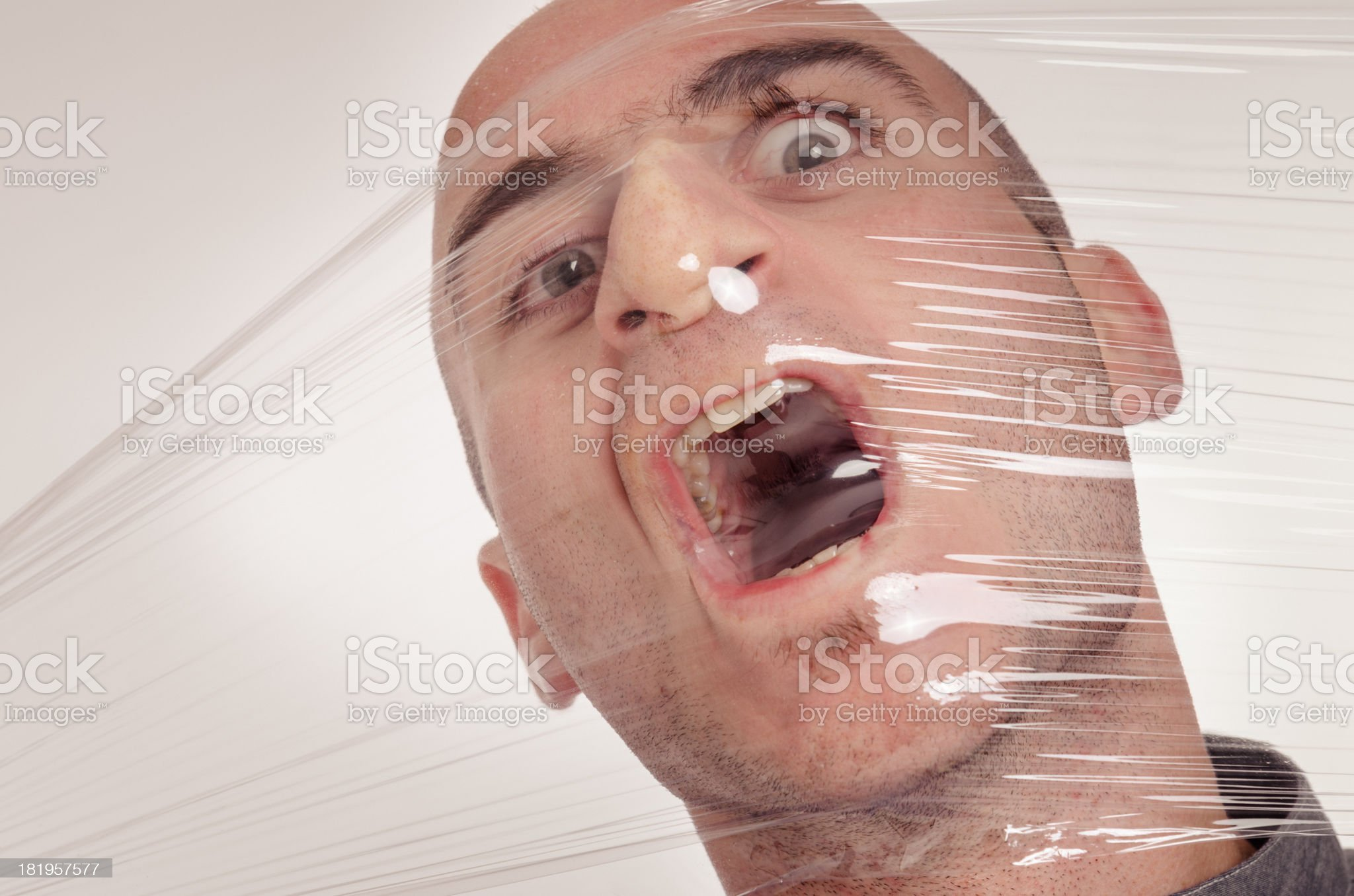asphyxiated man with celophan royalty-free stock photo