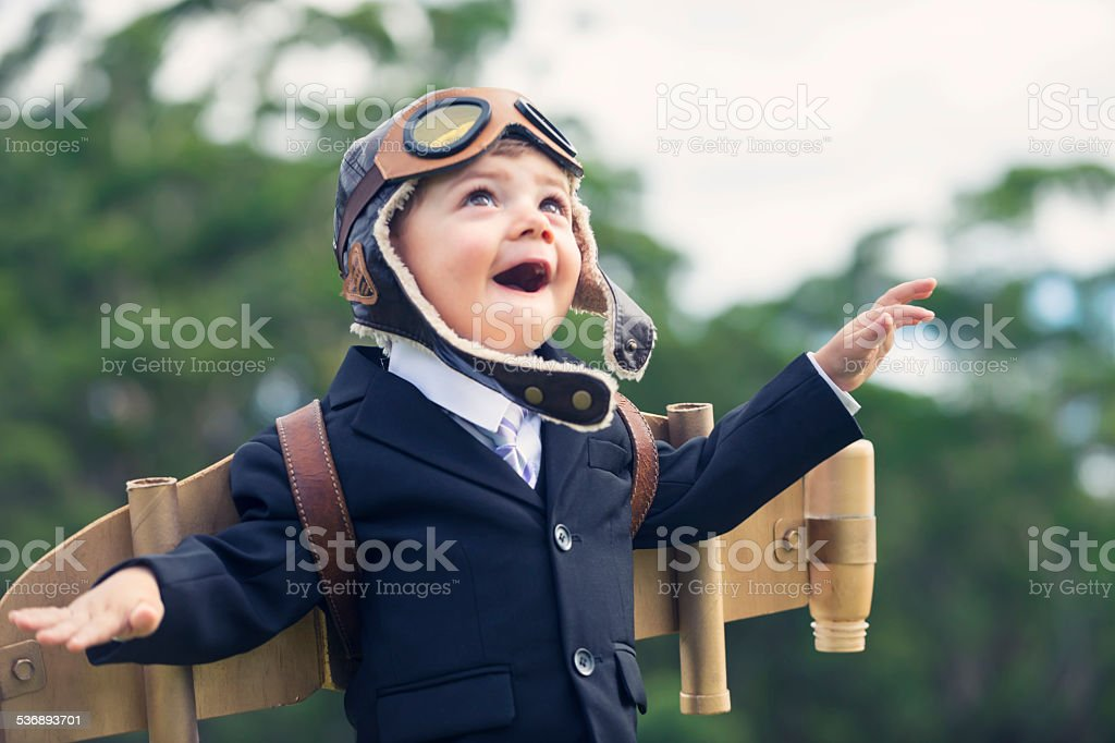 Aspiration, innovation business concept. Young child wearing hom stock photo