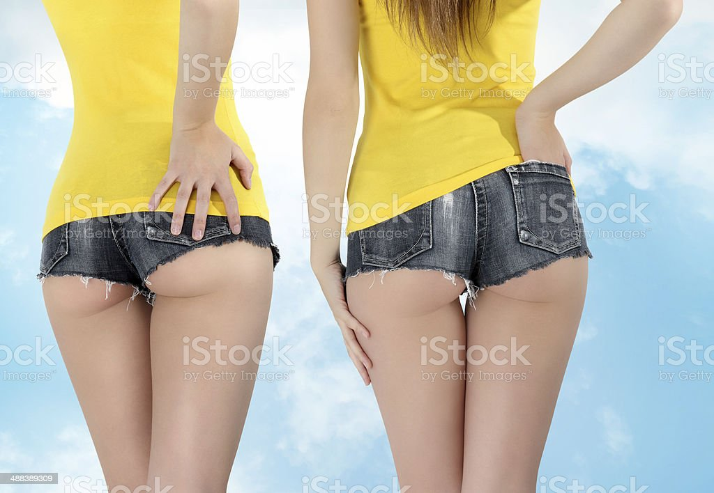 ass woman wearing a short jeans with yellow tank top stock photo
