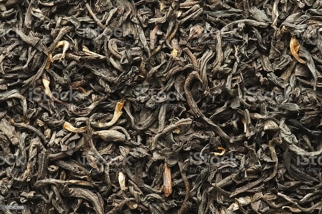 Assam tea leaves background from overhead stock photo