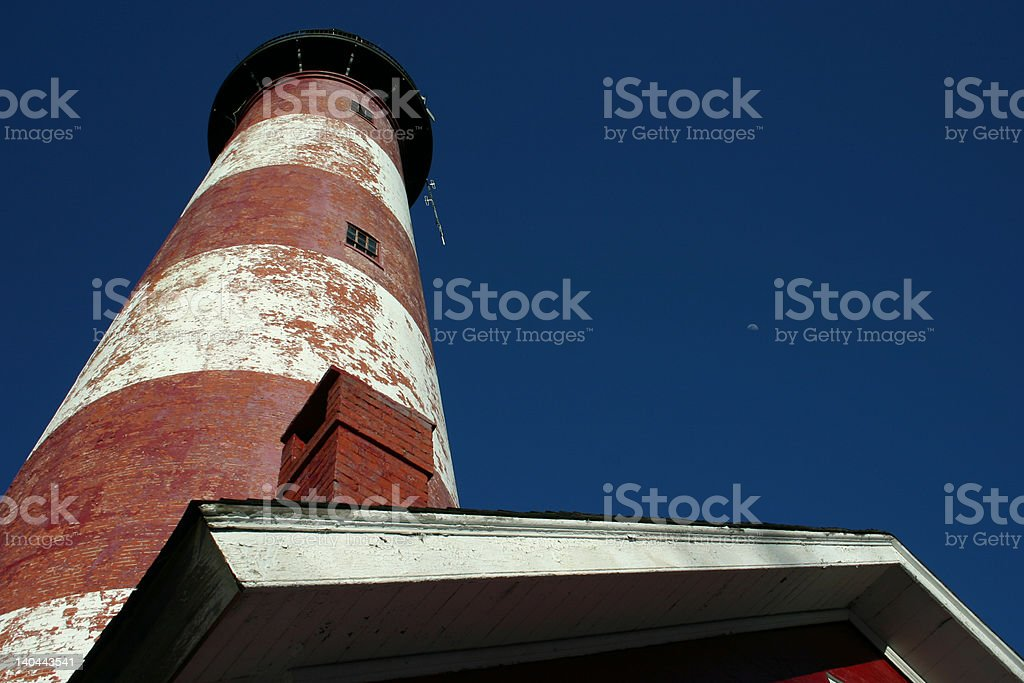 Assateague Lighthouse in the Summer with Moon royalty-free stock photo