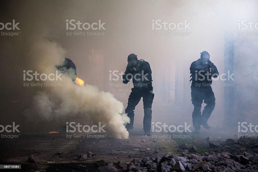 assault in the smoke stock photo