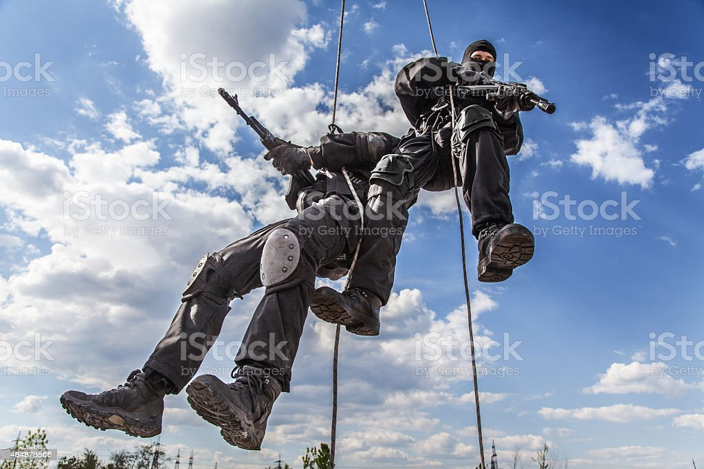 assault rappeling stock photo