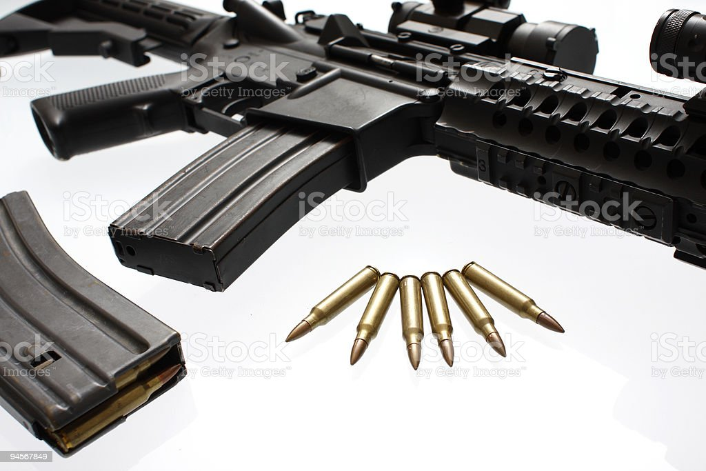 Assault rifle and extra ammo stock photo