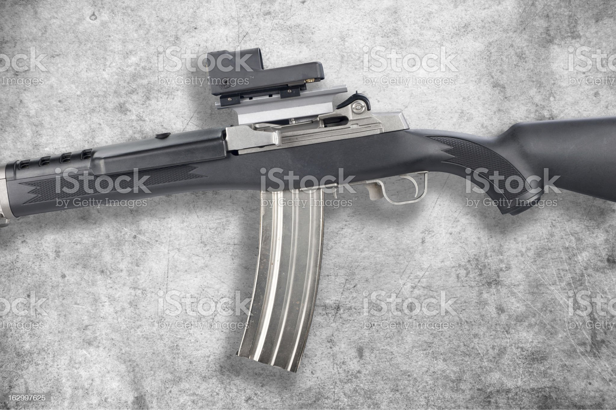 Assault rifle on grunge royalty-free stock photo