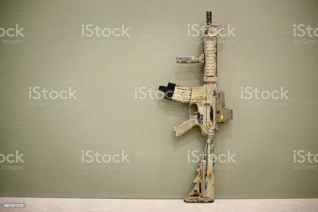 Assault Rifle, painted in sand color. stock photo