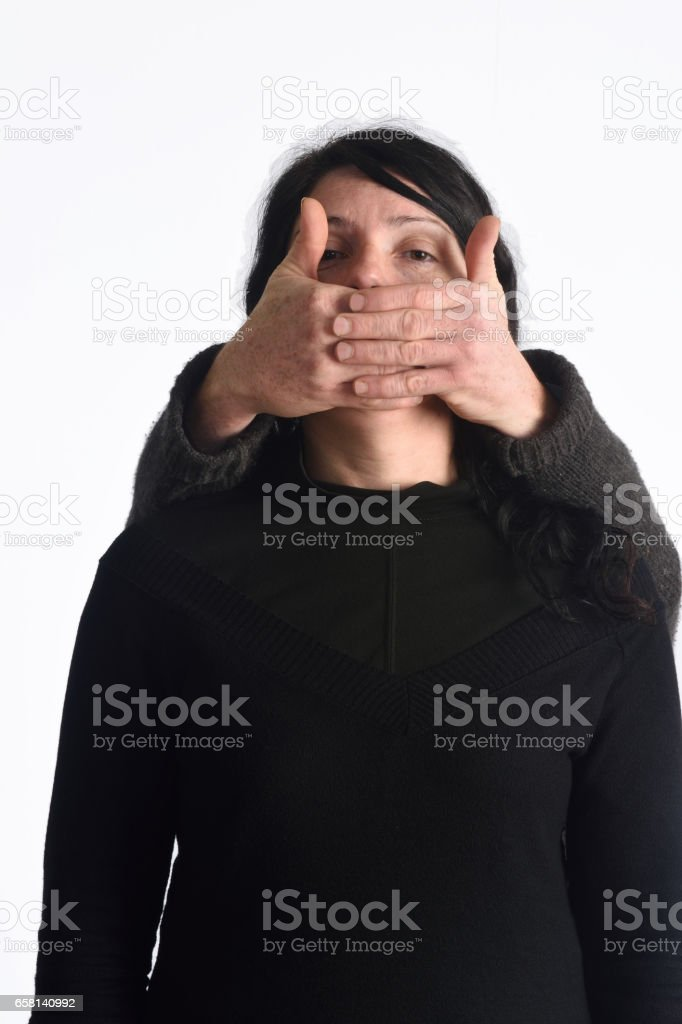 Assaulting and silencing a woman stock photo