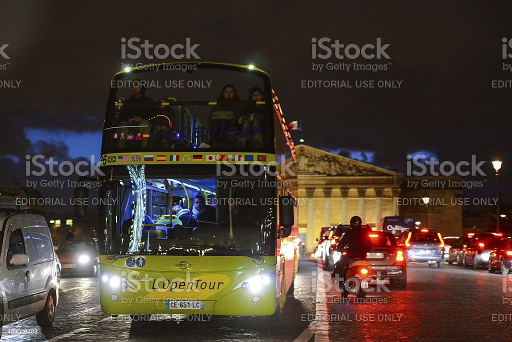 Assemblee Nationale and Open Tour Bus, Paris at night royalty-free stock photo
