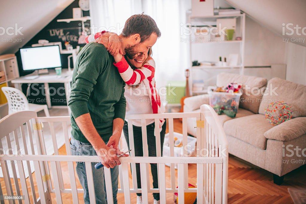 Assembling a baby crib stock photo