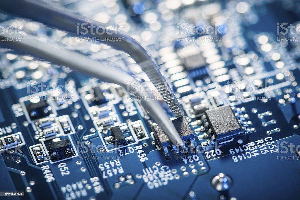 Assembling a circuit board. royalty-free stock photo