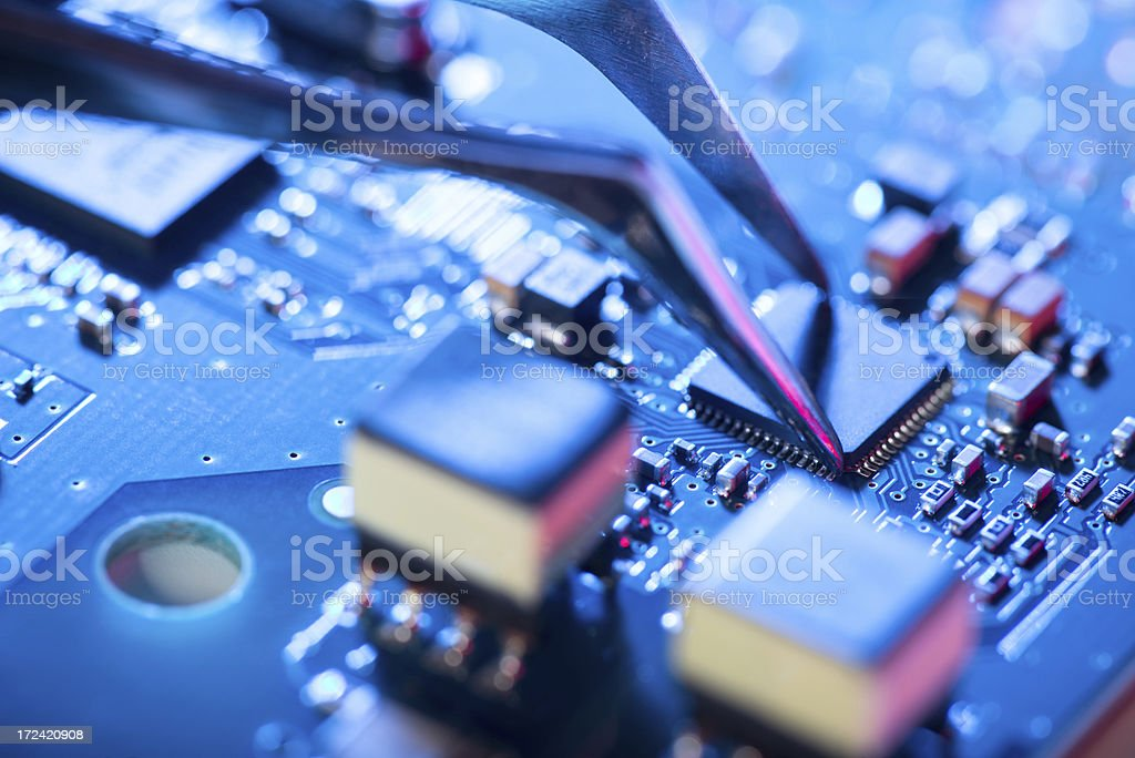 Assembling a circuit board. stock photo