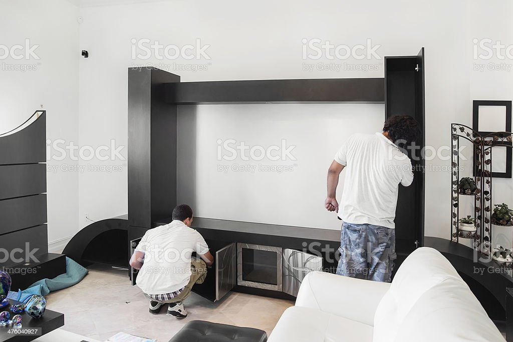 Assembling a new built in wall unit stock photo