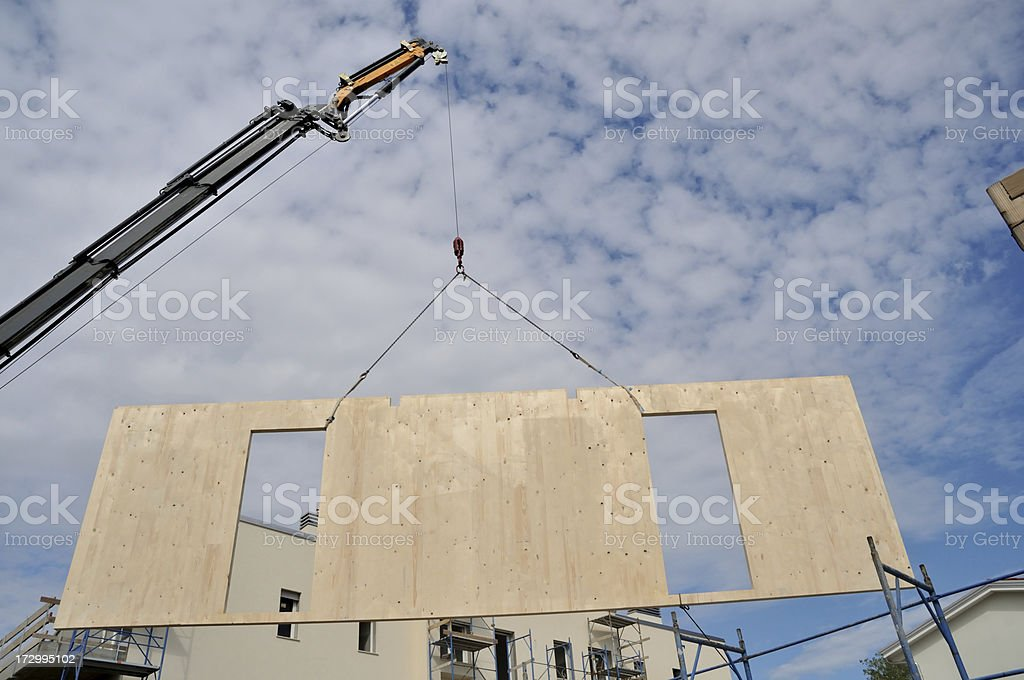 Assembling a prefab home stock photo
