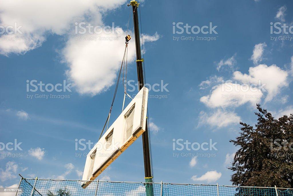 Assembling a prefabricated house stock photo