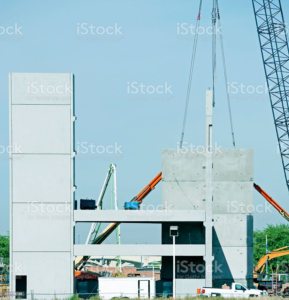 Assembling building from precast concrete slabs stock photo