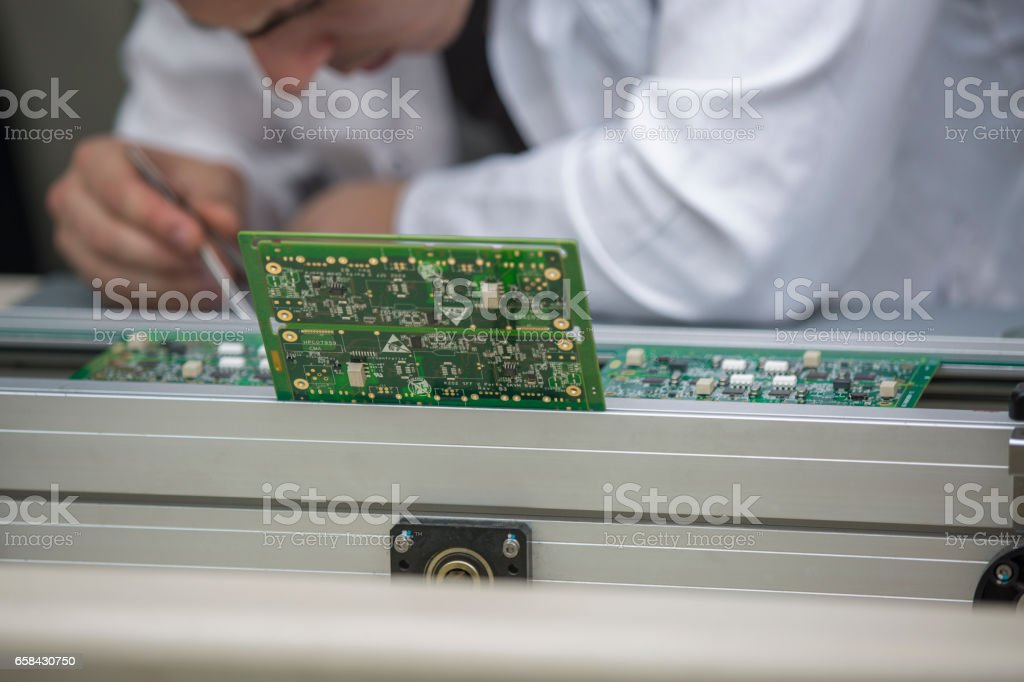 Assembling circuit board stock photo