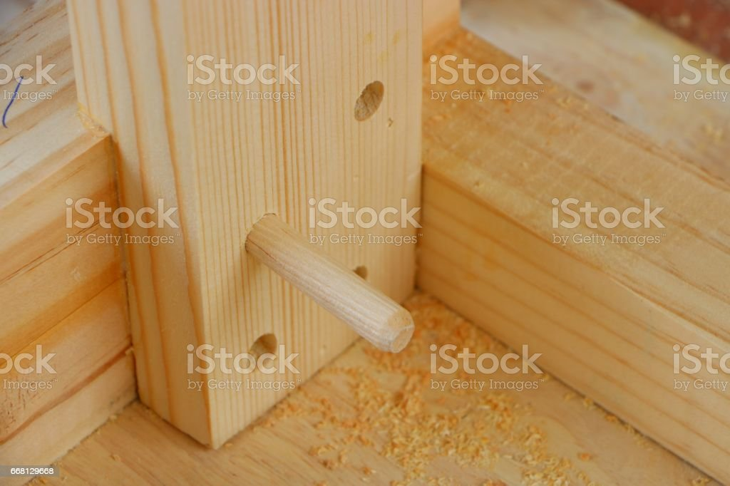 Assembling furniture, dowel joint stock photo