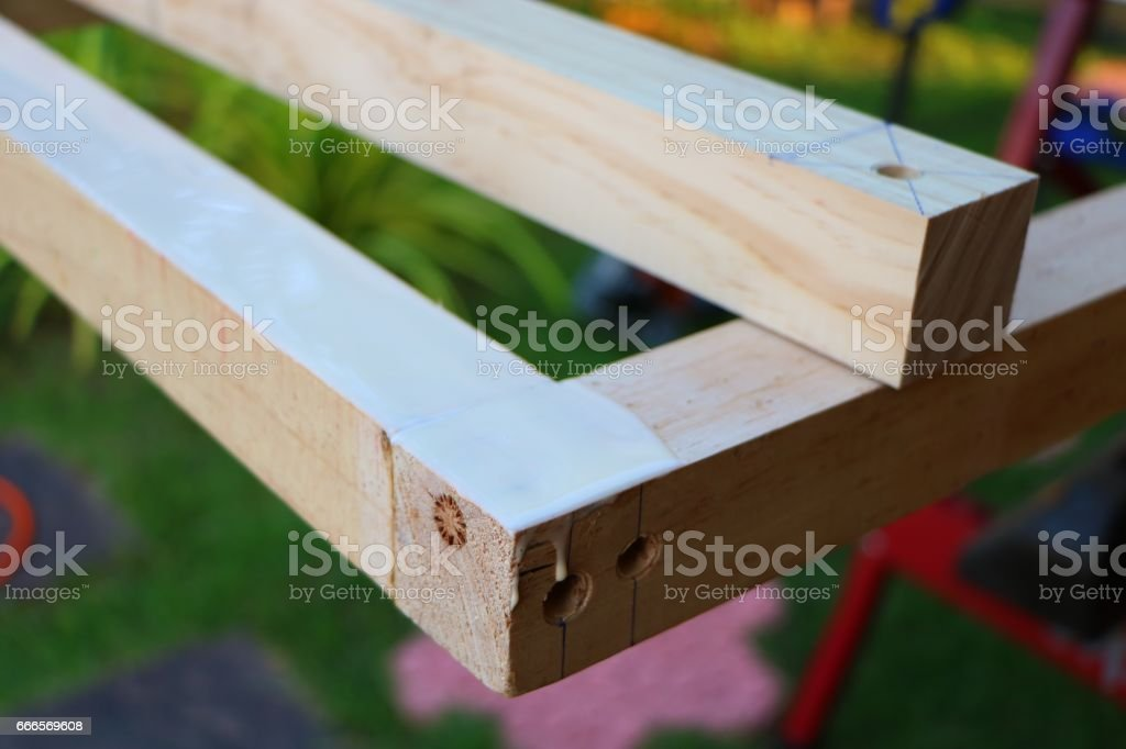 Assembling furniture, perforated hole stock photo