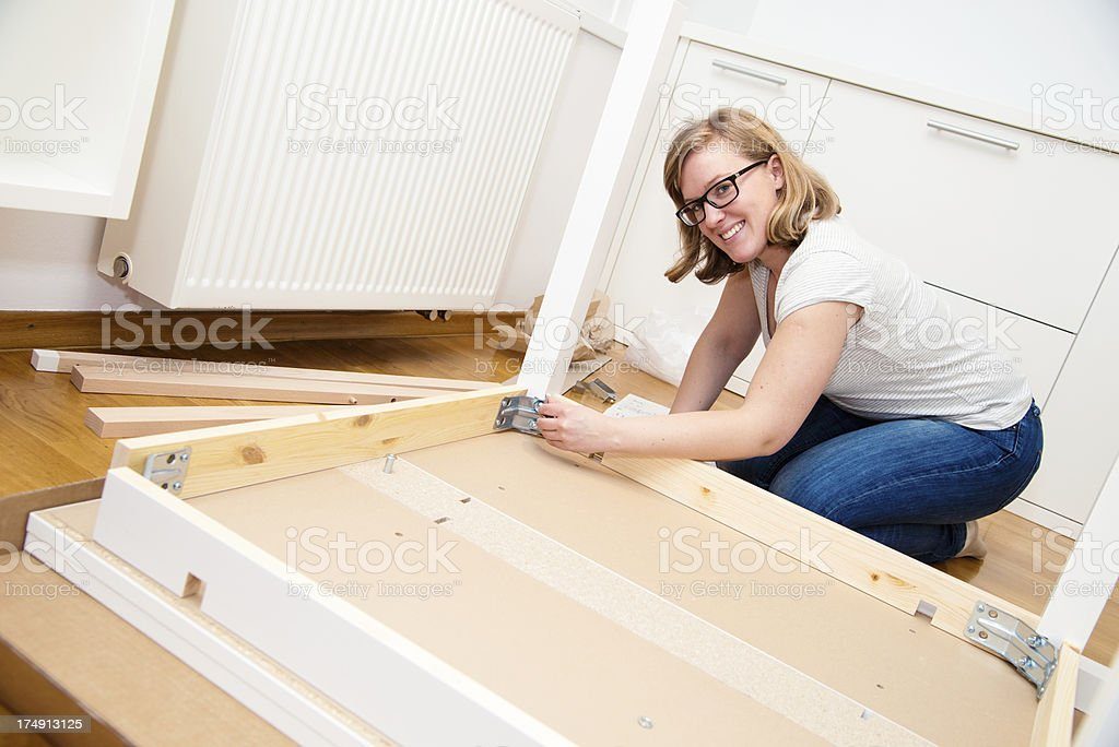 Assembling furniture royalty-free stock photo