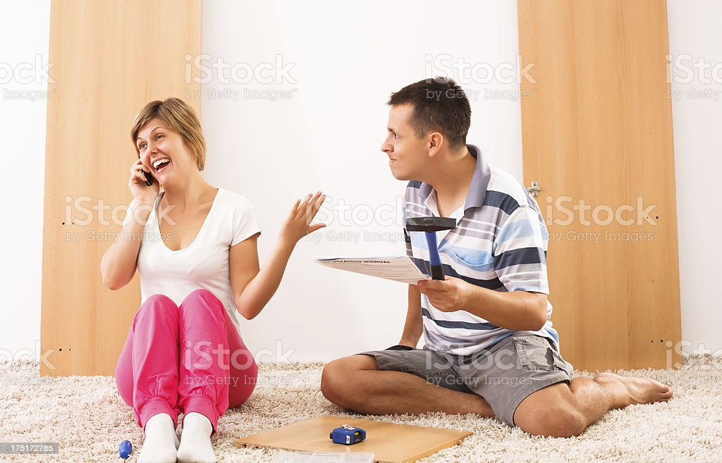 Assembling furniture stock photo
