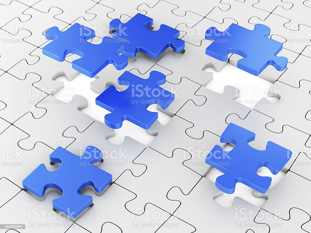 Assembling puzzles stock photo