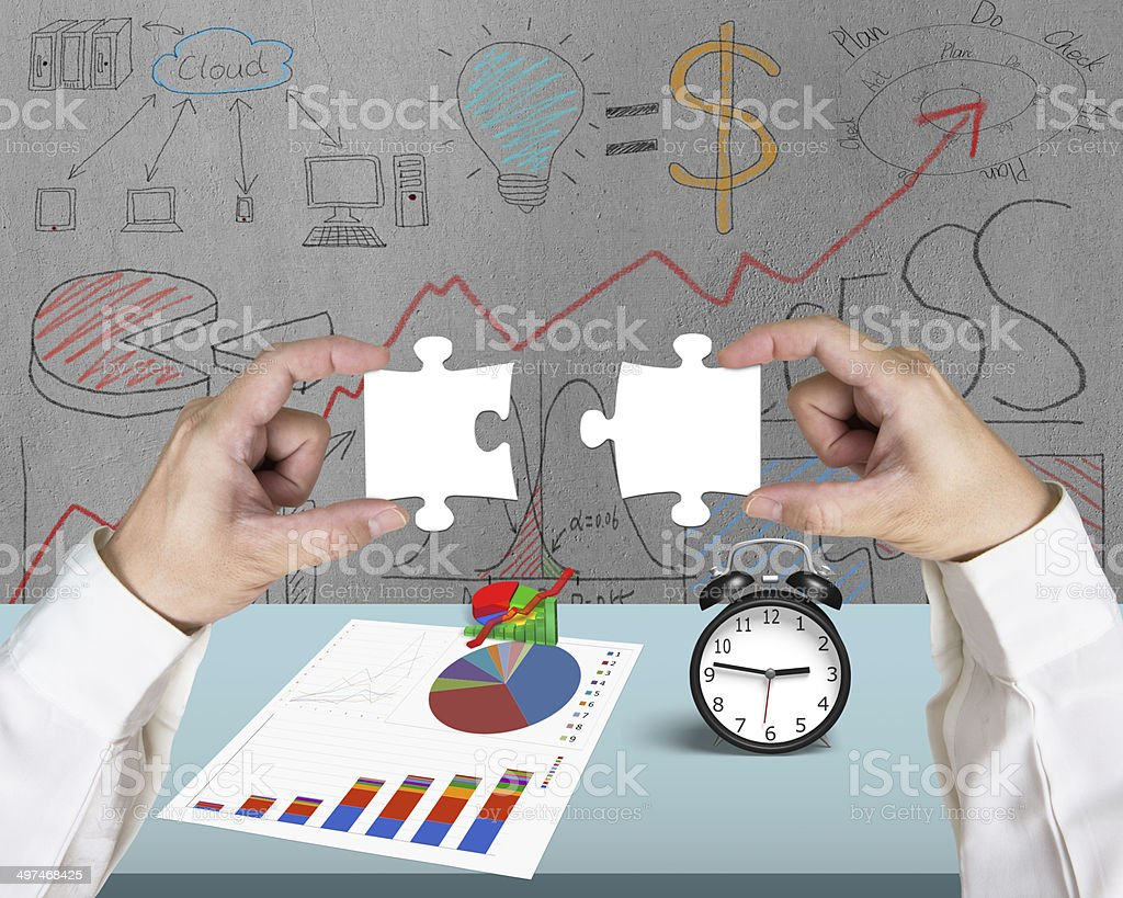 Assembling two puzzles royalty-free stock photo