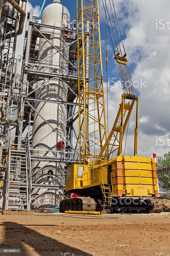 Assembly and installation of large vertical reactor at a refiner stock photo