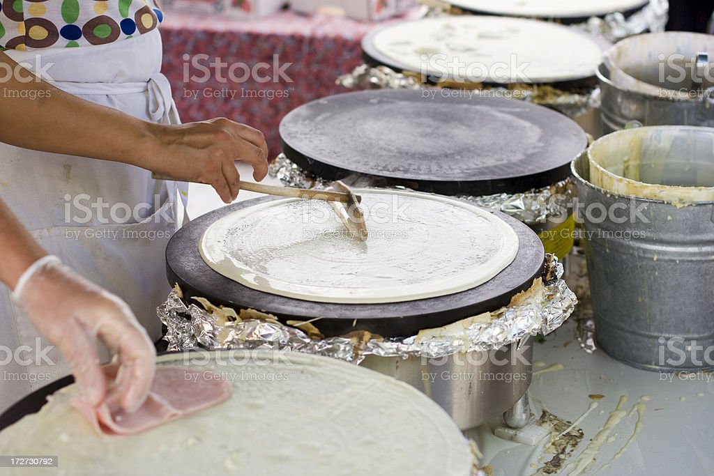 Assembly line making delicious fresh crepes at a farmers market royalty-free stock photo