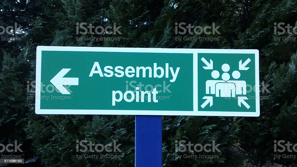 'Assembly Point' green safety sign stock photo
