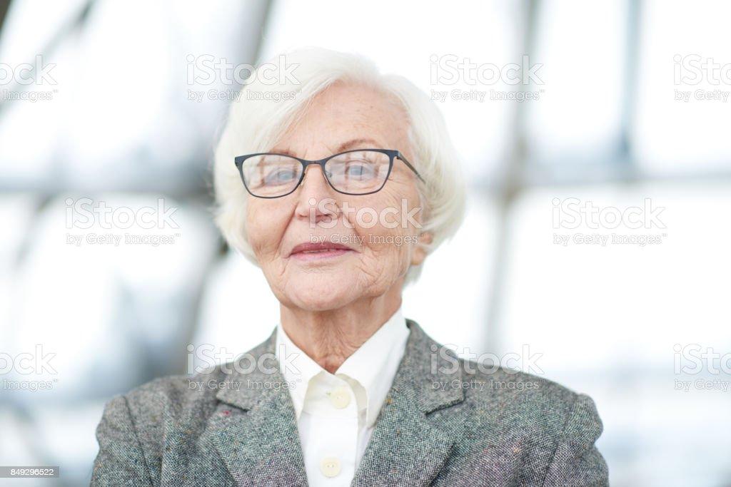Assertive senior female executive stock photo