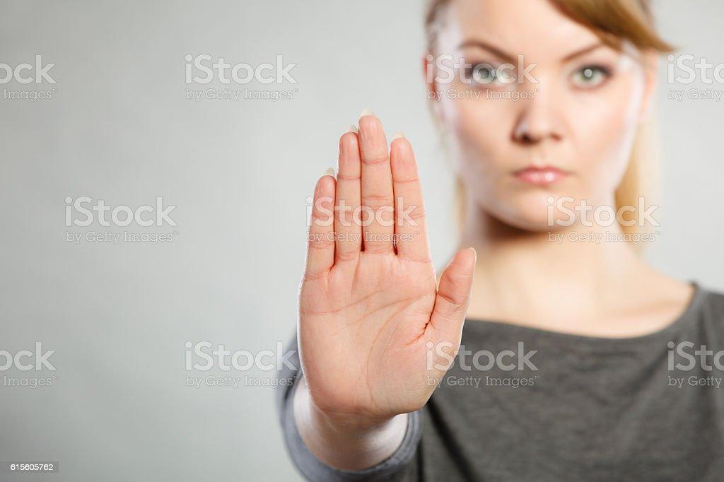 Assertive woman making stop gesture. stock photo