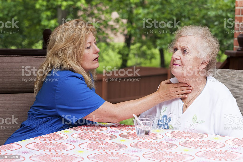 Assessing impaired swallowing after a stroke stock photo