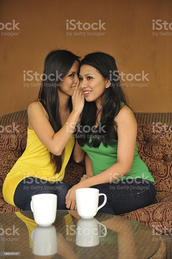 Assian gossiping friends stock photo