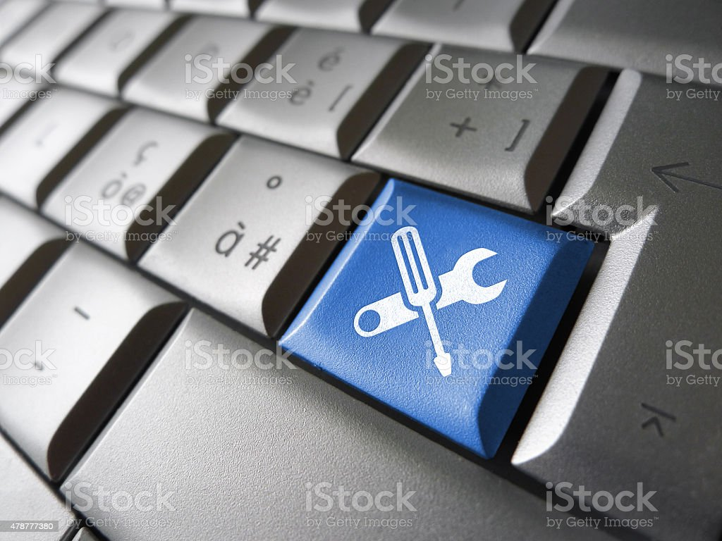 Assistance And Computer Service Key stock photo