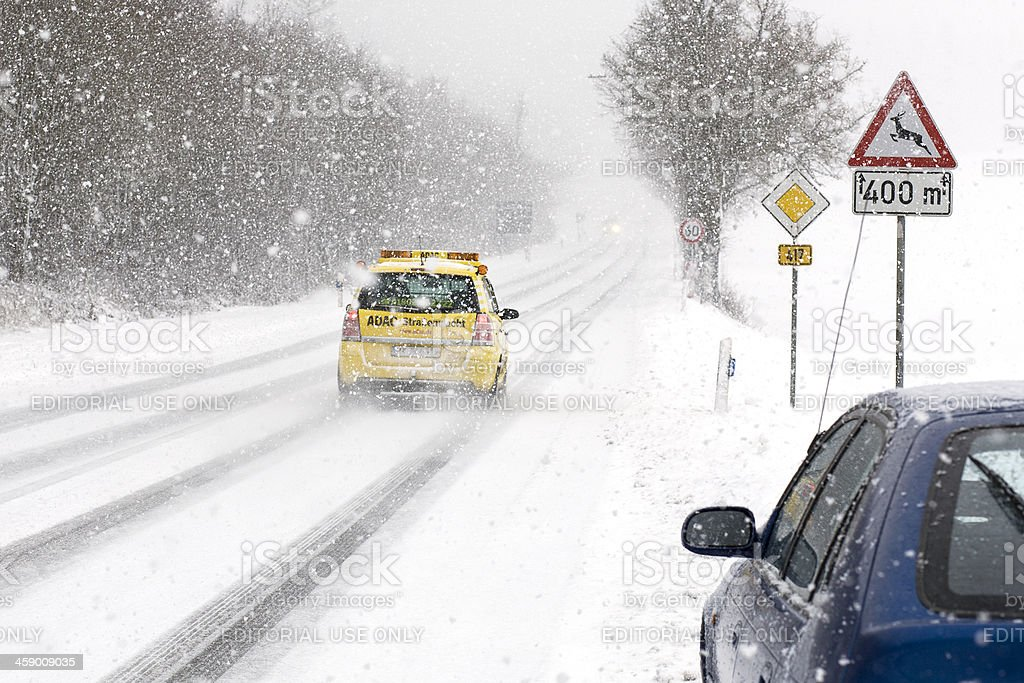 ADAC Assistance car in heavy snowstorm royalty-free stock photo