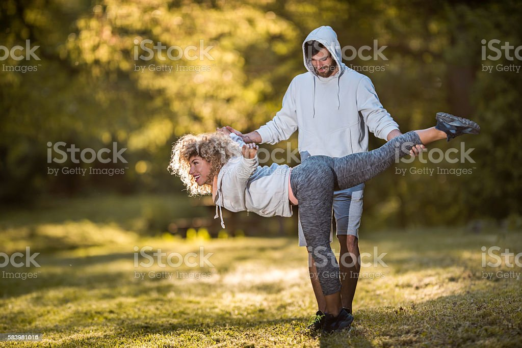 Assistance in doing balance exercises in nature! stock photo
