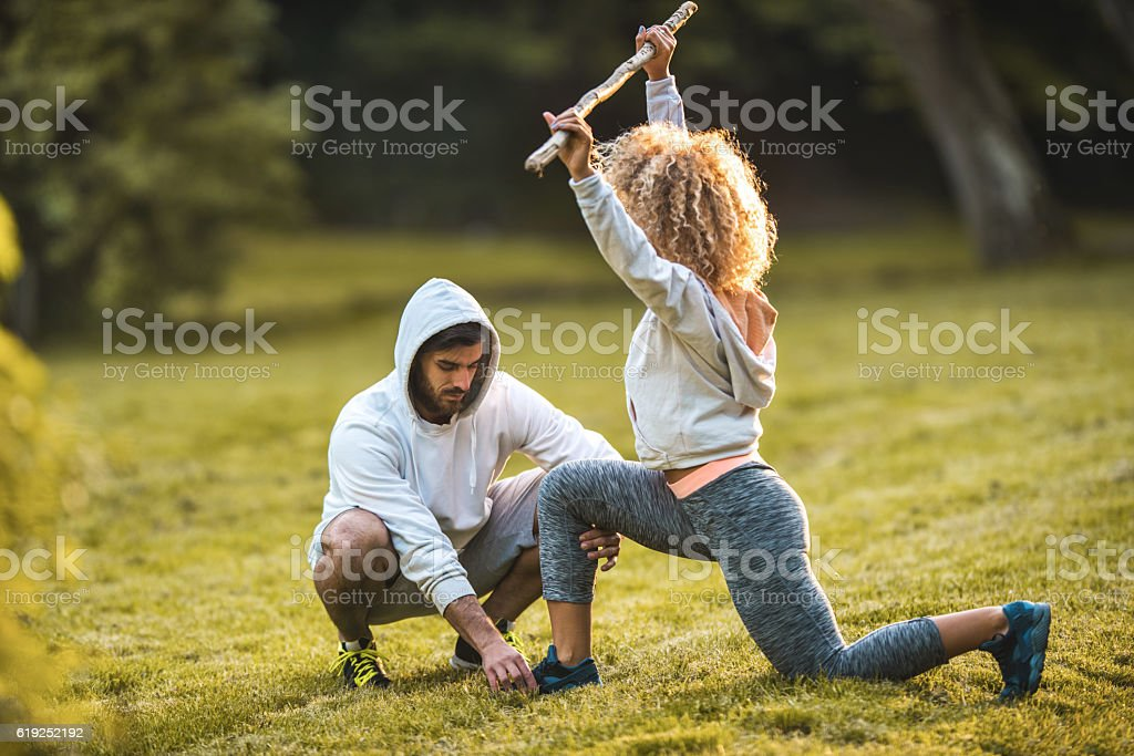 Assistance in doing balance exercises! stock photo