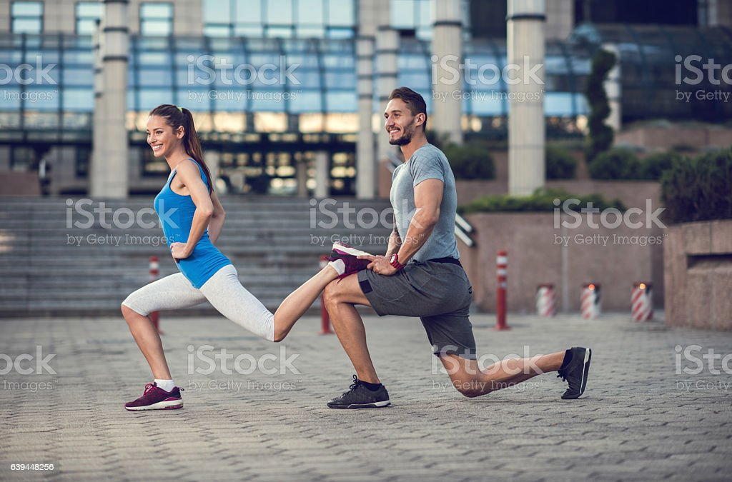 Assistance in exercising lunges! stock photo
