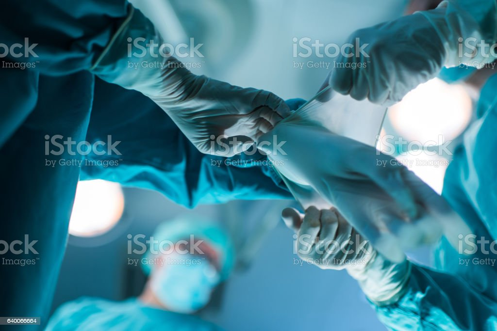 Assistance in putting surgical gloves! stock photo