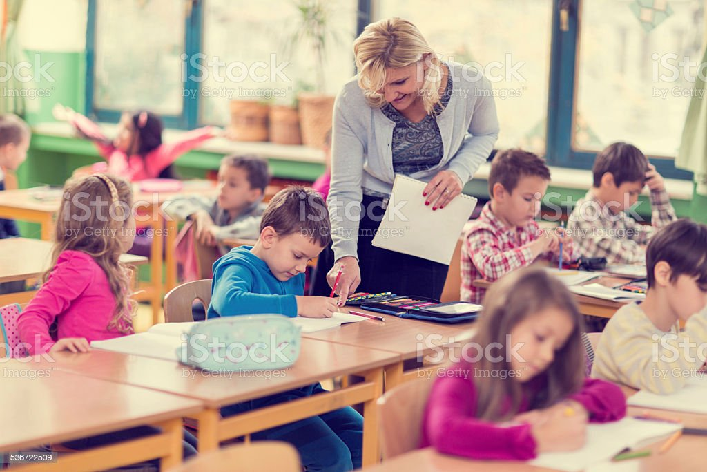 Assistance in the classroom. stock photo