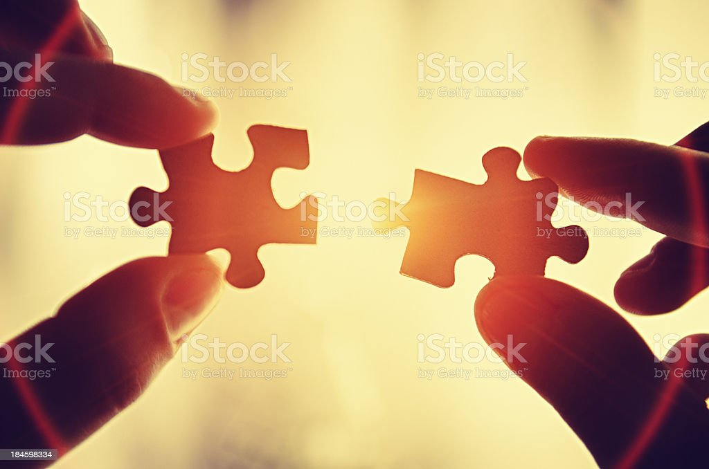 Assistance teamwork - puzzle connection stock photo