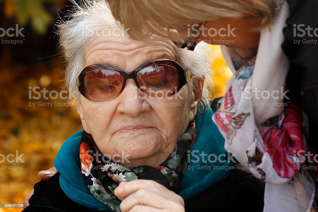 Assistance to elderly people stock photo