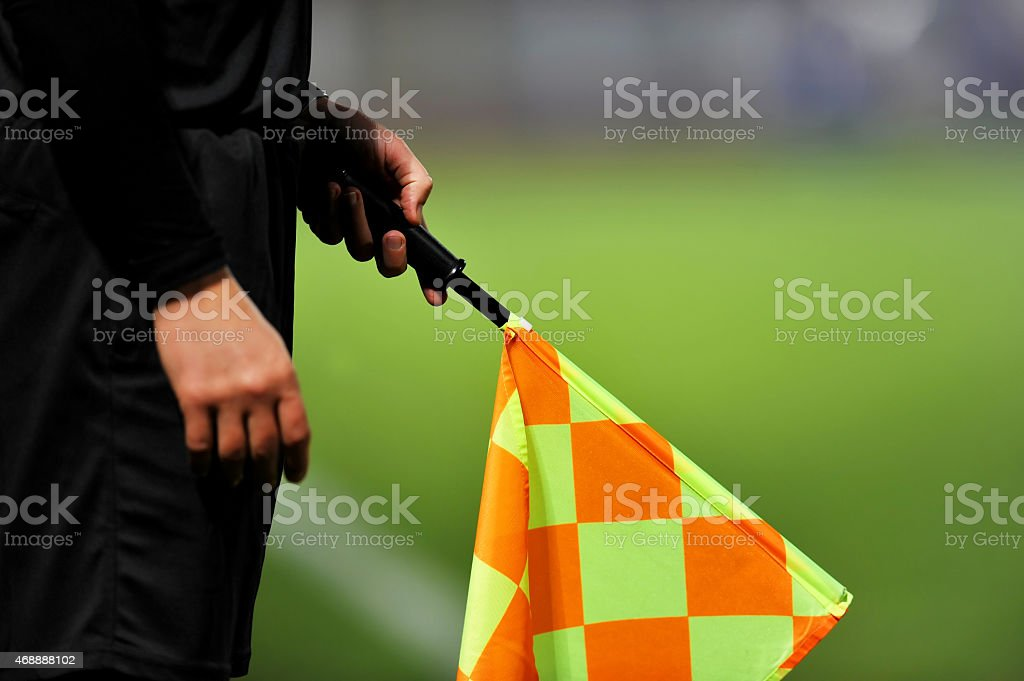 Assistant referee in action stock photo