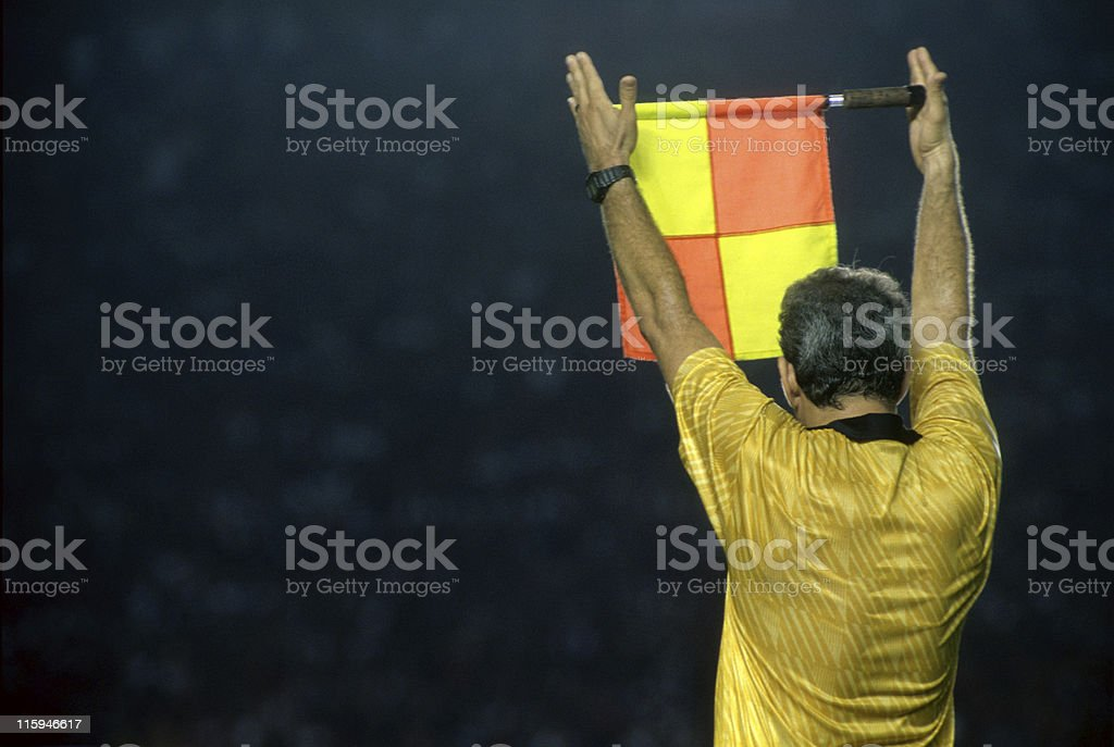 Assistant referee informing a substitution stock photo