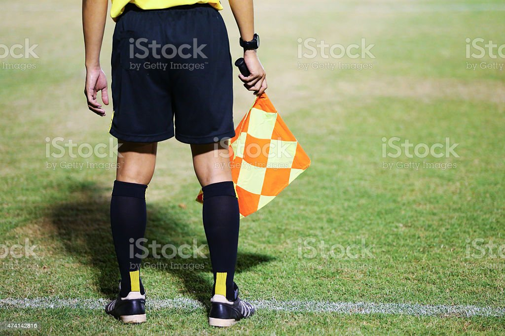 Assistant referees signalling stock photo